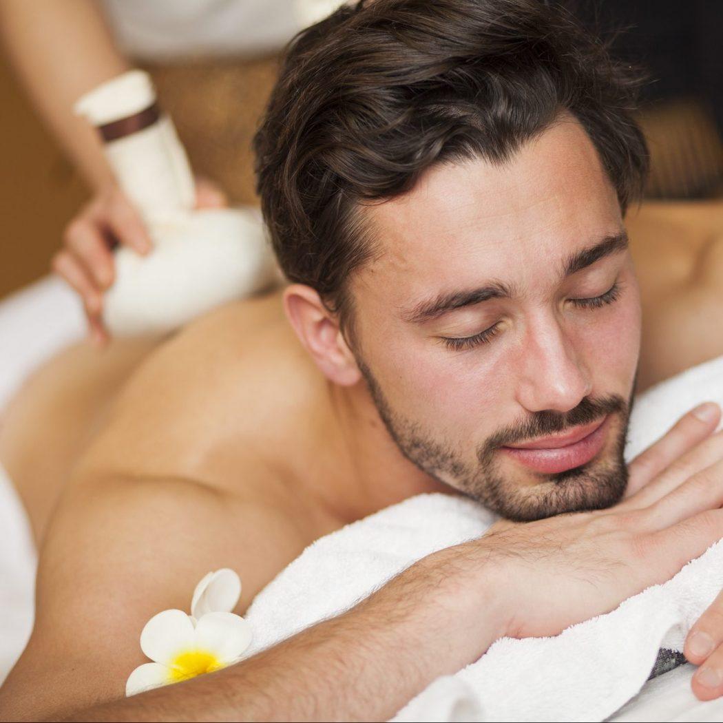 Man getting massage in Thai massage salon.