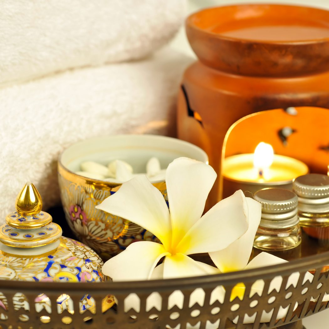 Thai Massage and Spa Treatment. Selected Focus on Plumeria Flowers. In the decoration Thai Style Cup is pure water with Jasmine flowers. Every things is on Old Bronze Tray.Spa Treatment and Thai Massage group: Please see some similar pictures from my portfolio: